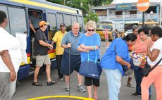 Cruise passengers leave bus after a land tour in Dominica today