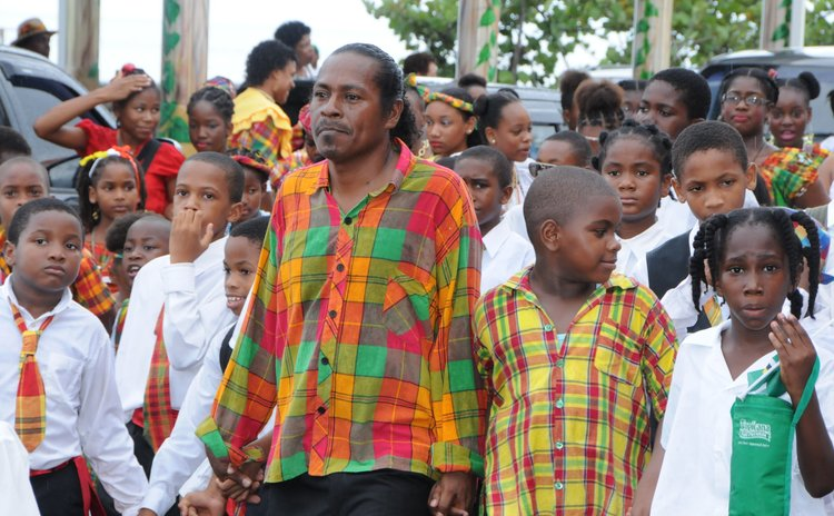 A teacher takes care of his pupils in the National Dress Parade