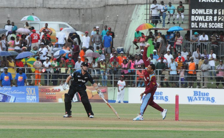 Narine bowls against New Zealand at the Windsor Park Sports Stadium in Roseau