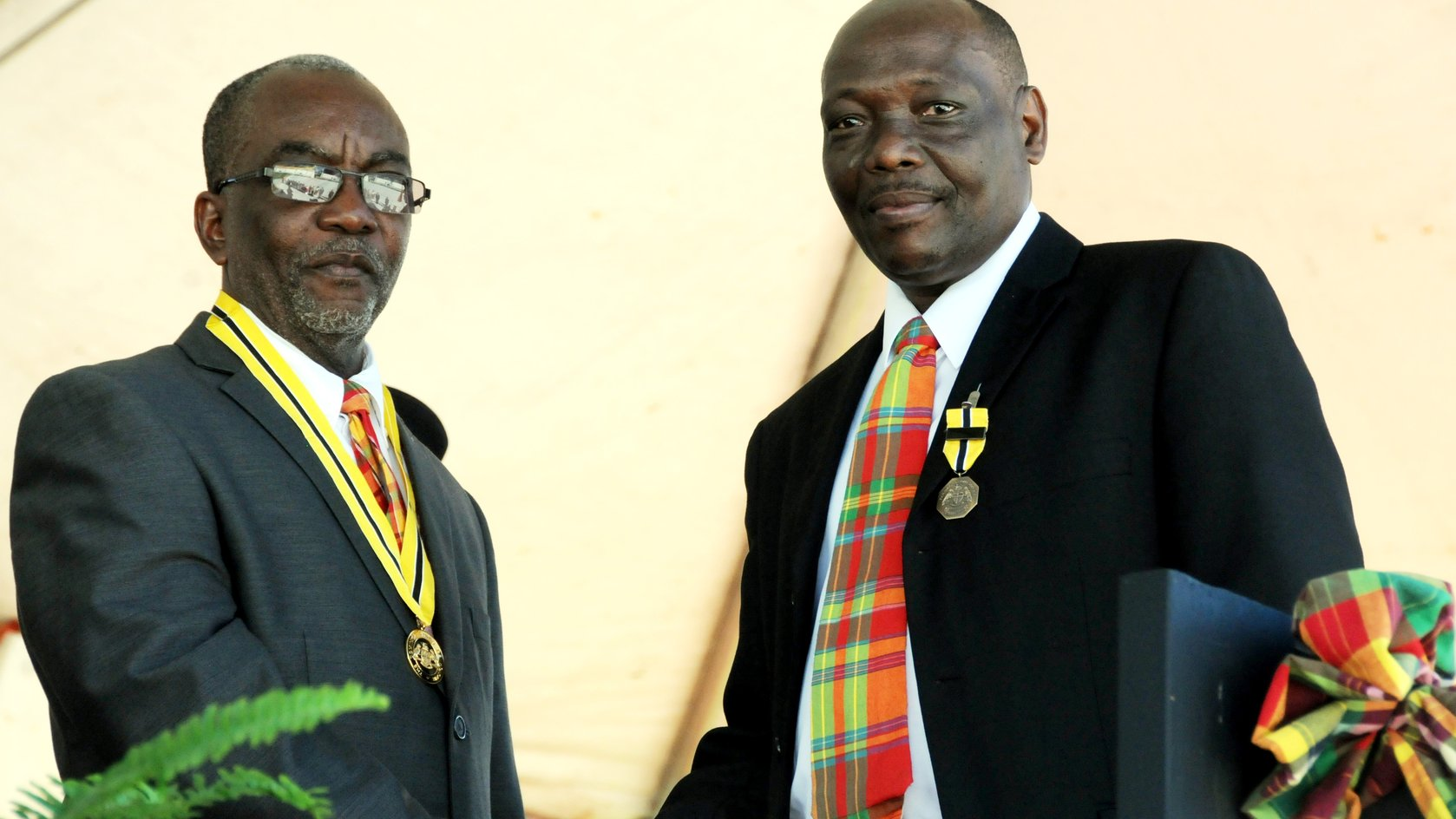 Bishop Bill Daniel,right, received award from President Eliud Williams in 2012