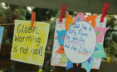 Signs at the Dominica Climate Change Day of Action at the Botanic Gardens, Roseau on Saturday November 28, 2015