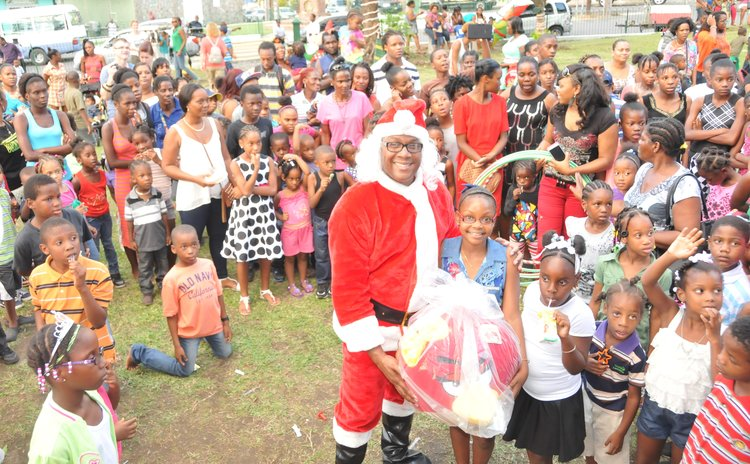Robert Tonge in Santa custume and children at Christmas function
