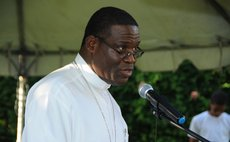 Bishop Malzaire speaks at the Dominica Climate Change Day of Action at the Botanic Gardens, Roseau on Saturday November 28, 2015