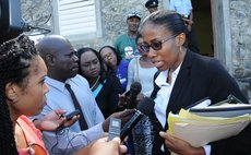 Defence Lawyer Shillingford talk to reporters after the case at the St. Joseph Magistrate's court on 8th December 2015