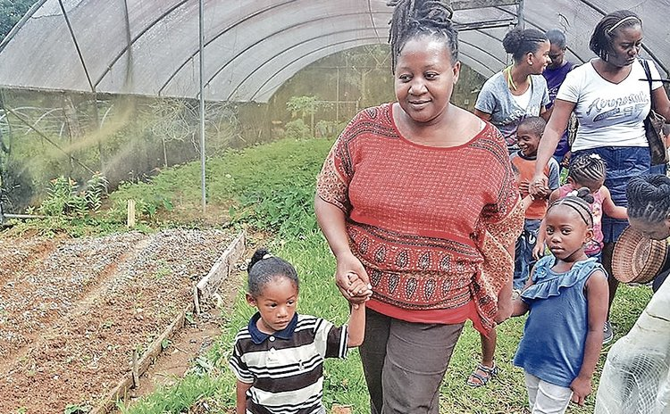 Dawn Francis leads a school tour on D-Smart Farm