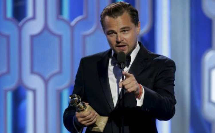 "Leonardo DiCaprio with trophy award for Best Actor in a Motion Picture - Drama for performance in movie ""The Revenant"" at the 73rd Golden Globe Awards in Los Angeles, Jan. 10, 2016. (Source: Chinanews"