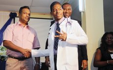All Saints Dominican student receives white coat