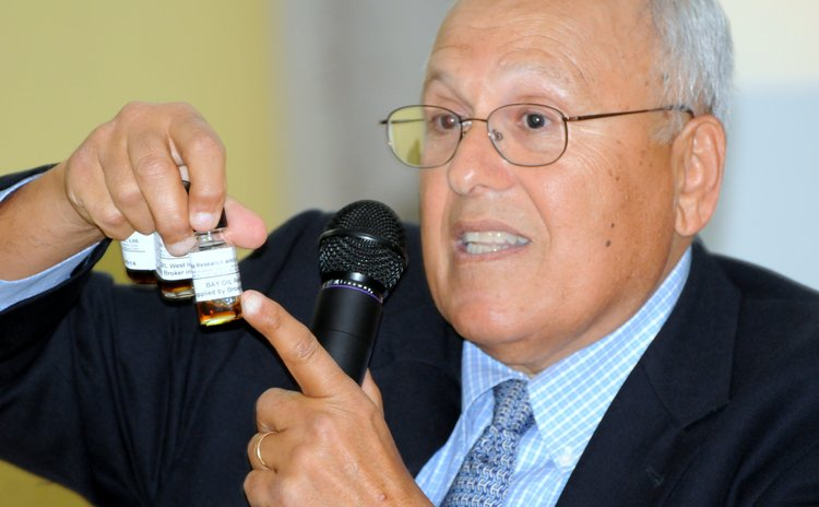 Dr. Nadim Shaath shows samples of essential oils at the meeting of essential oils stakeholders