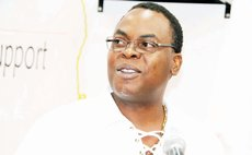 Dr. Christmas speaks to the Dominica Society AGM