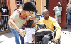 Dr Sam Christian greets his daughter on his arrival from medical treatment in  Martinique
