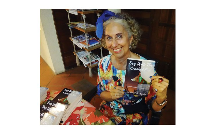The author, Dr Janet Taylor, displays her book