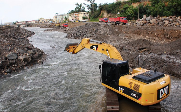 Dredging the Roseau River after Hurricane Maria