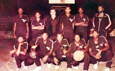 John Keller Eagles II with trophies, pose with their coach (standing, far Right) and sponsor (standing, 2nd from Left). Photo courtesy: Leroy Dover