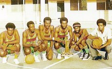 ELECTRONS pose with 1974 Knockout Championship trophy (L-R): Cuthbert Robinson, Hubert Charles, George Daniel, Errol Blackman, Al Monelle, Eddie Royer