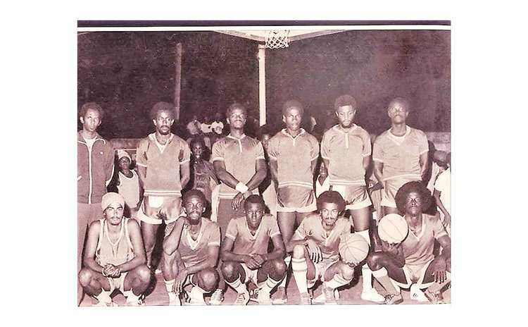 Trevor Knight (standing, 2nd from Right) and Emanuel Loblack (stooping, far Right) on 1976 National Basketball Team, 2nd Windwards Basketball Tournament