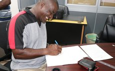 A farmer signs the contract
