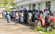 Farmers gather at Division of Agriculture, Roseau for World Bank Grant