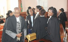 Mary Roberts , president of the Dominica Bar Association, and other female lawyers at the High Court