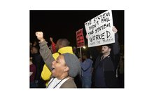 WASHINGTON D.C., Nov. 25, 2014 (Xinhua) -- People protest against the grand jury's decision not to charge police officer Darren Wilson in the fatal shooting of African American youth Michael Brown