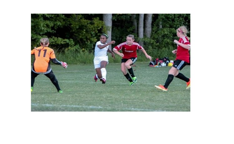 DC Stoddert's Sari Finn unleashes a left foot shot at goal against Virginia Beach FC