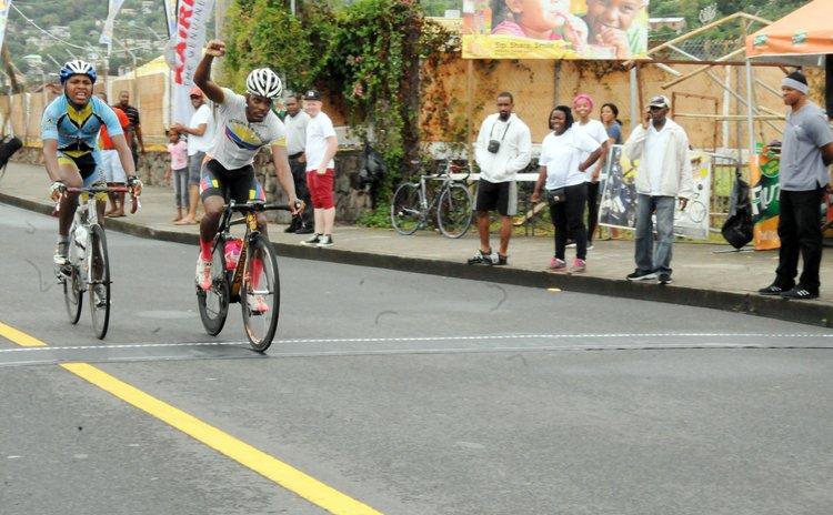 Jyme Bridges crosses the finish line; Andrew Norbert is next