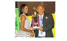DFA President Glen Etienne hands trophy to Female Footballer of the Year