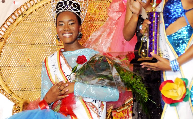 Miss Dominica Francine Baron after she was crowned at the Windsor Park Stadium on Saturday morning