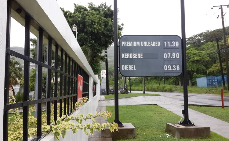 Gas prices at September 15, 2015: Sign at NP gas station in Canefield