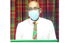 Health minister McIntyre wears COVID mask