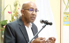 Health Minister Dr. Irving McIntyre at a COVID-19 national consultation