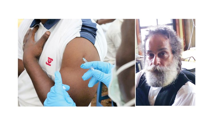 Man takes COVID-19 Jab and right, Lawyer Henry Shillingford