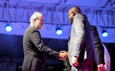 Dr lennox Honychurch greets PM Skerrit after Honychurch receives awaard at Independence Day ceremony 2018