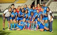 Martinique team pose after the tournament at the Windsor Park Sports Stadium
