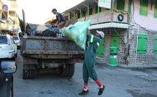 Garbage collectors on Roseau street