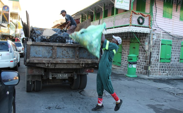 Garbage collectors on Roseau street