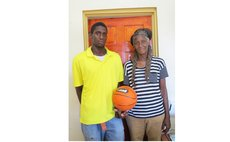 "Athlene Magloire with son Tilon Birmingham. Missing ""basketball children"" are Ahlai-Anna, Kirby and Maxwell"