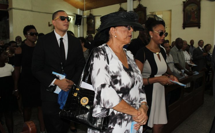 Judith Pestaina, front row, at the funeral of her husband