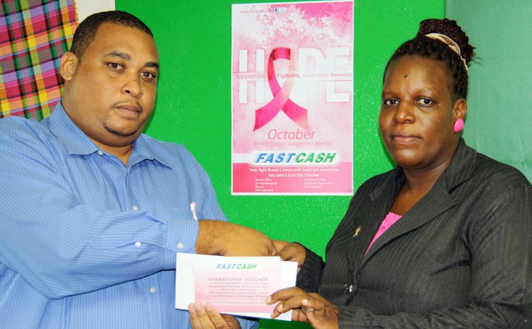 President of the Dominica Cancer Society accepts donation from Fast Cash official