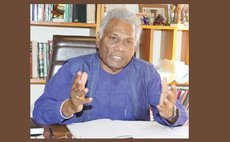 Israel Khan at his office ( Photo courtesy Trinidad Guardian)