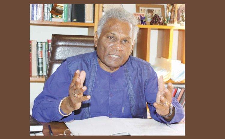 Israel Khan at his office ( Photo courtesy Trinidad Guardian)