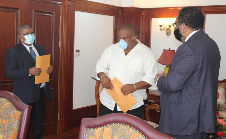 Left to right: James, Shillingford and President Savarin at the swearing in of members of the Electoral Commission