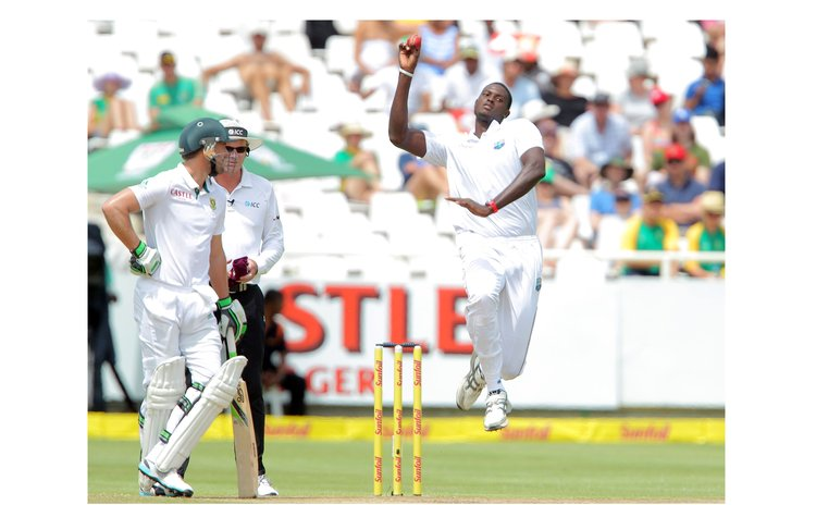 Jason Holder bowls against South Africa