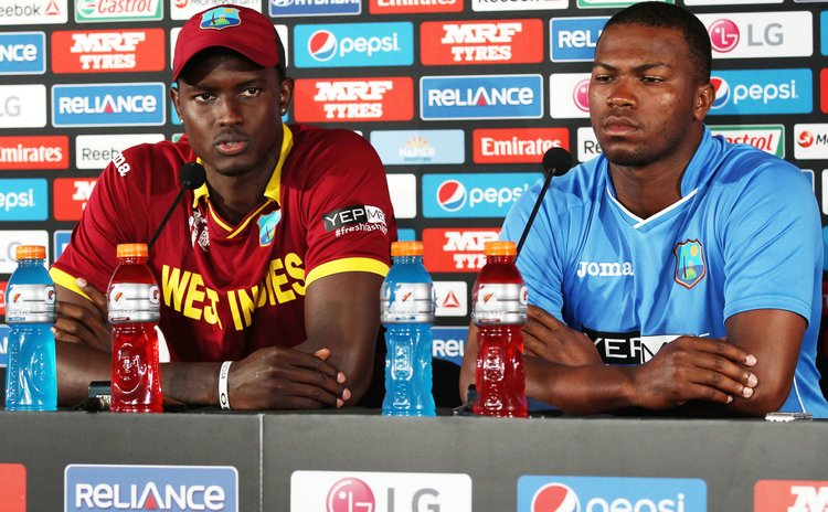 Jason Holder and Johnson Charles at the post-match press conference