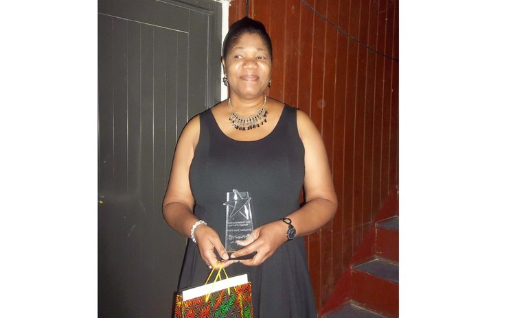 Jermaine Jean-Pierre shows her awards