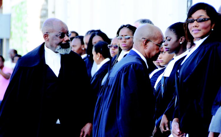 Judge Errol Thomas, left, and law officials at the opening of the New Law Year