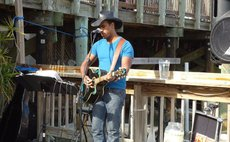 Julian Riviere plays guitar