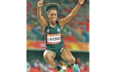 In flight: Long Jumper LaFond at the Commonwealth Games