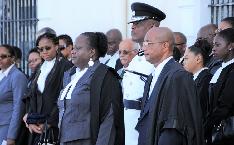 Judge Stephenson, centre front; Registrar Ossie Walsh,right front, Police Commissioner Carbon and members of the Dominica Bar