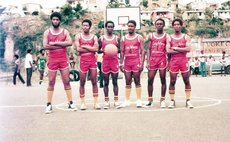 Ambassadors in uniforms made by player Russell Moreau (L); 1980