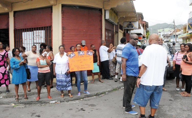 Supporters of the UWP gather outside law office to pay fine